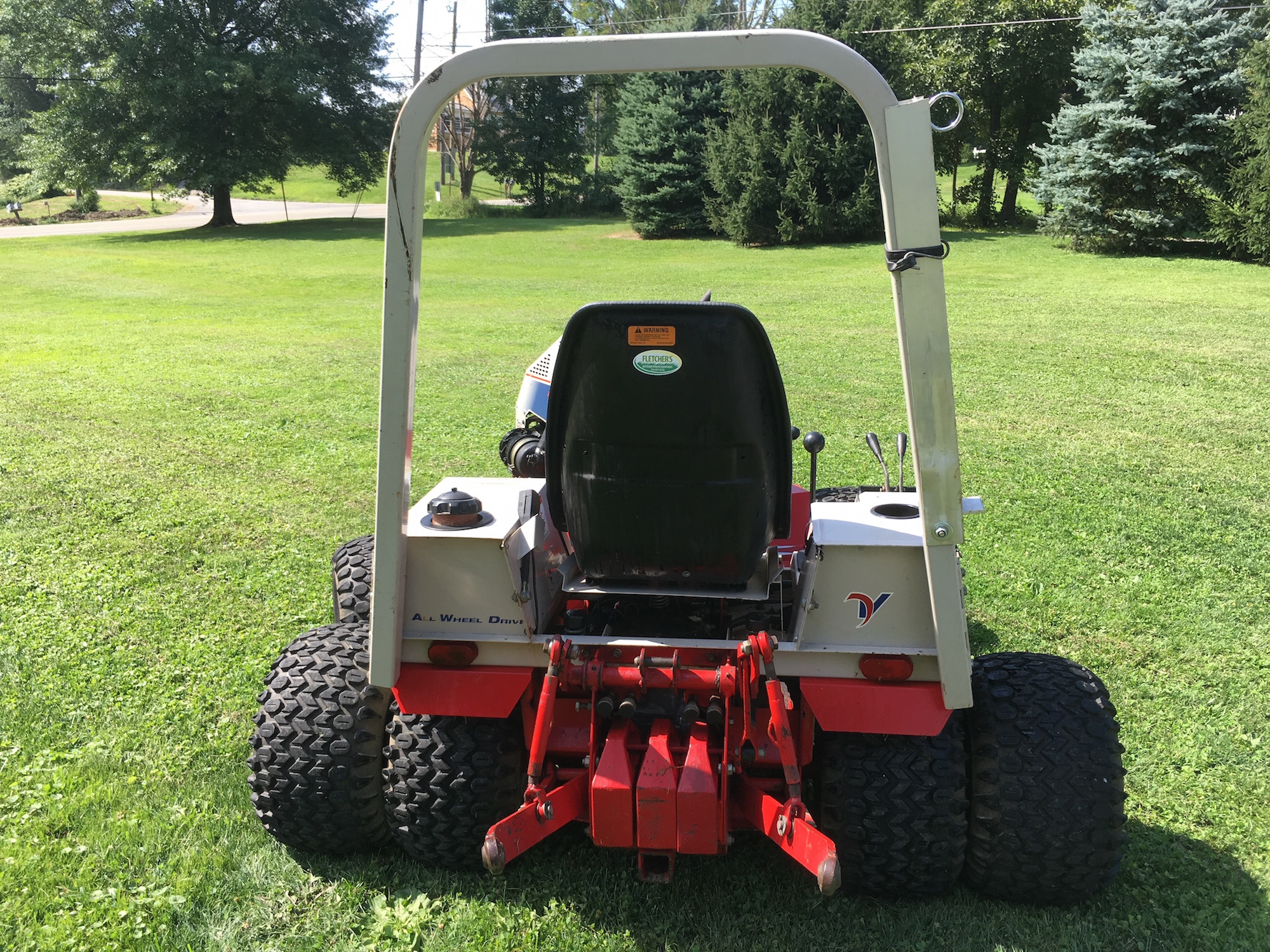 Ventrac 4200VXD AWD Tractor with Finish Mower, Rotary Cutter